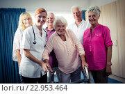 Купить «Portrait of a group of pensioners with nurse», фото № 22953464, снято 22 марта 2016 г. (c) Wavebreak Media / Фотобанк Лори