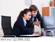 Купить «two happy employees in office», фото № 22956332, снято 21 сентября 2019 г. (c) Яков Филимонов / Фотобанк Лори