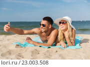 Купить «happy couple in swimwear walking on summer beach», фото № 23003508, снято 11 августа 2015 г. (c) Syda Productions / Фотобанк Лори