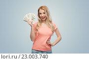 Купить «happy young woman with usa dollar cash money», фото № 23003740, снято 30 апреля 2016 г. (c) Syda Productions / Фотобанк Лори