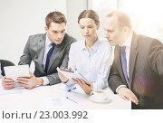 Купить «business team with tablet pc having discussion», фото № 23003992, снято 9 ноября 2013 г. (c) Syda Productions / Фотобанк Лори