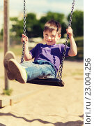 Купить «happy little boy swinging on swing at playground», фото № 23004256, снято 13 июня 2015 г. (c) Syda Productions / Фотобанк Лори