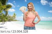 Купить «happy young woman with usa dollar cash money», фото № 23004328, снято 30 апреля 2016 г. (c) Syda Productions / Фотобанк Лори