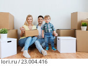 Купить «happy family with boxes moving to new home», фото № 23004416, снято 25 февраля 2016 г. (c) Syda Productions / Фотобанк Лори