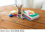 Купить «close up of stationery or school supplies on table», фото № 23004432, снято 17 марта 2016 г. (c) Syda Productions / Фотобанк Лори