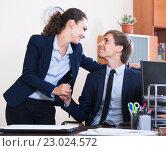 Купить «Top manager flirting with subordinate official at workplace», фото № 23024572, снято 27 февраля 2020 г. (c) Яков Филимонов / Фотобанк Лори
