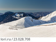 Купить «Ski resort Rosa Khutor. Mountains of Krasnaya Polyana. Sochi, Russia», фото № 23028708, снято 10 февраля 2016 г. (c) Сергей Лаврентьев / Фотобанк Лори