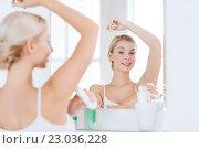 woman with antiperspirant deodorant at bathroom. Стоковое фото, фотограф Syda Productions / Фотобанк Лори