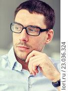 Купить «portrait of businessman in eyeglasses at office», фото № 23036324, снято 18 июня 2015 г. (c) Syda Productions / Фотобанк Лори