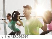 Купить «group of people exercising with barbell in gym», фото № 23036620, снято 5 апреля 2015 г. (c) Syda Productions / Фотобанк Лори