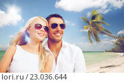 Купить «happy couple in sunglasses at maldives beach», фото № 23036644, снято 14 июля 2013 г. (c) Syda Productions / Фотобанк Лори