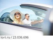 Купить «happy man and woman driving in cabriolet car», фото № 23036696, снято 15 июля 2015 г. (c) Syda Productions / Фотобанк Лори