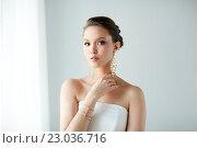 Купить «beautiful asian woman with earrings and bracelet», фото № 23036716, снято 9 апреля 2016 г. (c) Syda Productions / Фотобанк Лори