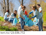 Купить «volunteers with garbage bags cleaning park area», фото № 23036772, снято 7 мая 2016 г. (c) Syda Productions / Фотобанк Лори