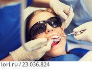Купить «female dentists treating patient girl teeth», фото № 23036824, снято 23 мая 2015 г. (c) Syda Productions / Фотобанк Лори