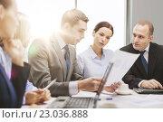 Купить «business team with laptop having discussion», фото № 23036888, снято 9 ноября 2013 г. (c) Syda Productions / Фотобанк Лори