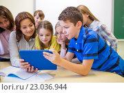 Купить «group of kids with teacher and tablet pc at school», фото № 23036944, снято 15 ноября 2014 г. (c) Syda Productions / Фотобанк Лори
