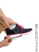 Купить «Athlete wearing trainer shoes», фото № 23037348, снято 14 октября 2015 г. (c) Wavebreak Media / Фотобанк Лори