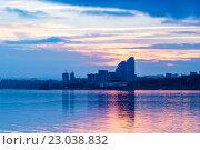 Купить «Город на фоне заката. Здания с отражением в реке», фото № 23038832, снято 24 ноября 2015 г. (c) Денис Дряшкин / Фотобанк Лори