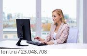 Купить «young businesswoman with computer typing at office», видеоролик № 23048708, снято 16 марта 2016 г. (c) Syda Productions / Фотобанк Лори