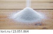 Купить «white sugar pouring into heap on wooden table», видеоролик № 23051864, снято 2 апреля 2016 г. (c) Syda Productions / Фотобанк Лори