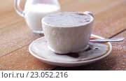 Купить «cup full of spilled coffee and sugar on table», видеоролик № 23052216, снято 15 апреля 2016 г. (c) Syda Productions / Фотобанк Лори