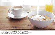 Купить «sugar pouring to corn flakes on wooden table», видеоролик № 23052224, снято 15 апреля 2016 г. (c) Syda Productions / Фотобанк Лори