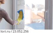 Купить «woman in gloves cleaning window with rag», видеоролик № 23052256, снято 16 апреля 2016 г. (c) Syda Productions / Фотобанк Лори