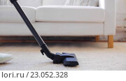 Купить «woman with vacuum cleaner cleaning carpet at home», видеоролик № 23052328, снято 17 апреля 2016 г. (c) Syda Productions / Фотобанк Лори