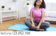 Купить «happy african woman exercising on mat at home», видеоролик № 23052708, снято 6 мая 2016 г. (c) Syda Productions / Фотобанк Лори