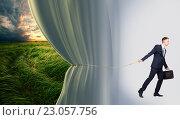 Купить «Young businessman beginning the ecology presentation, conceptual idea», фото № 23057756, снято 11 мая 2016 г. (c) Владимир Мельников / Фотобанк Лори