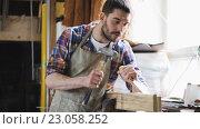 Купить «carpenter with chisel working at workshop», видеоролик № 23058252, снято 21 мая 2016 г. (c) Syda Productions / Фотобанк Лори