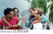 Купить «Young hipsters are having fun », видеоролик № 23059508, снято 19 августа 2019 г. (c) Wavebreak Media / Фотобанк Лори
