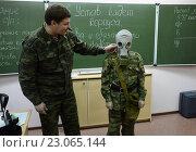 Купить «Обучение одевания противогаза в кадетском корпусе полиции», фото № 23065144, снято 24 октября 2013 г. (c) Free Wind / Фотобанк Лори