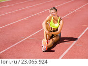 Купить «Female athlete sitting on the running track», фото № 23065924, снято 13 января 2016 г. (c) Wavebreak Media / Фотобанк Лори