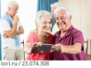 Купить «Seniors taking a selfie», фото № 23074308, снято 2 марта 2016 г. (c) Wavebreak Media / Фотобанк Лори