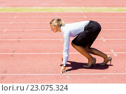 Купить «Businesswoman ready to run on running track», фото № 23075324, снято 13 января 2016 г. (c) Wavebreak Media / Фотобанк Лори