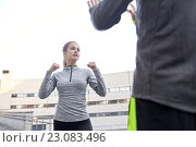 Купить «woman with trainer working out self defense strike», фото № 23083496, снято 17 октября 2015 г. (c) Syda Productions / Фотобанк Лори