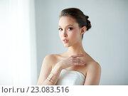 Купить «beautiful asian woman with ring and bracelet», фото № 23083516, снято 9 апреля 2016 г. (c) Syda Productions / Фотобанк Лори