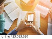 Купить «students with smartphones making cheat sheets», фото № 23083620, снято 6 марта 2015 г. (c) Syda Productions / Фотобанк Лори