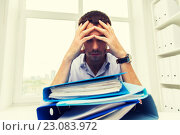 Купить «sad businessman with stack of folders at office», фото № 23083972, снято 18 июня 2015 г. (c) Syda Productions / Фотобанк Лори