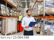 Купить «businessman with clipboard at warehouse», фото № 23084048, снято 9 декабря 2015 г. (c) Syda Productions / Фотобанк Лори