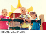 Купить «happy little girls on children playground», фото № 23084236, снято 13 июня 2015 г. (c) Syda Productions / Фотобанк Лори