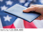 Купить «close up of hand with american passport», фото № 23084480, снято 6 мая 2016 г. (c) Syda Productions / Фотобанк Лори