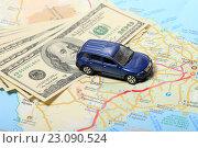 Купить «Автомобиль и деньги на фоне карты дорог», эксклюзивное фото № 23090524, снято 14 июня 2016 г. (c) Яна Королёва / Фотобанк Лори