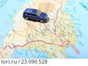 Купить «Автомобиль на фоне карты острова в Греции», эксклюзивное фото № 23090528, снято 14 июня 2016 г. (c) Яна Королёва / Фотобанк Лори