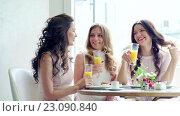 Купить «Smiling girls in a cafe», видеоролик № 23090840, снято 10 июня 2016 г. (c) Raev Denis / Фотобанк Лори