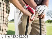 Купить «Composite image of hands holding golf club», фото № 23092008, снято 27 июня 2019 г. (c) Wavebreak Media / Фотобанк Лори