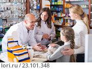 Купить «Two pharmacists helping customers», фото № 23101348, снято 24 февраля 2019 г. (c) Яков Филимонов / Фотобанк Лори