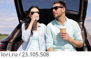 Купить «happy couple with coffee at hatchback car trunk 10», видеоролик № 23105508, снято 15 июня 2016 г. (c) Syda Productions / Фотобанк Лори